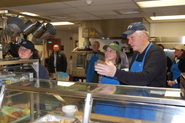 Terry McAuliffe helps out at Embry Rucker Shelter in Reston