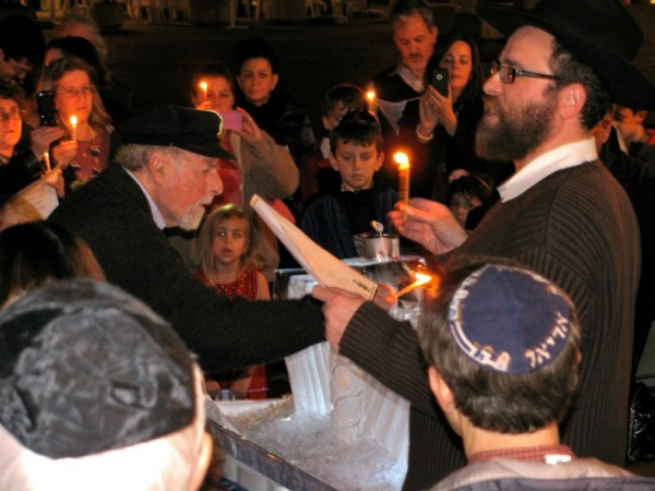 Reston founder Robert E. Simon lights the menorah at celebration at Lake Anne in 2011/Photo Courtesy of Chabad of Reston - Herndon