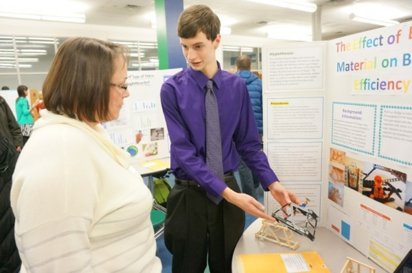 SLHS student explains his project to Principal Kim Retzer at 2014 Science Fair
