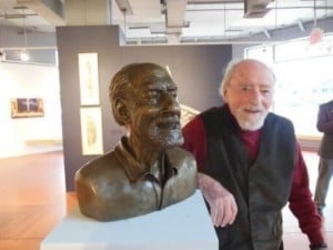 Reston  founder Robert E. Simon next to statue of his likeness.