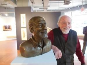Reston founder Robert E. Simon next to statue of his likeness.
