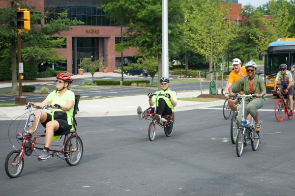 Hunter Mill Supervisor Cathy Hudgins (R) and other bicycle advocates pedal to Wiehle-Reston East for the garage grand opening July 19.