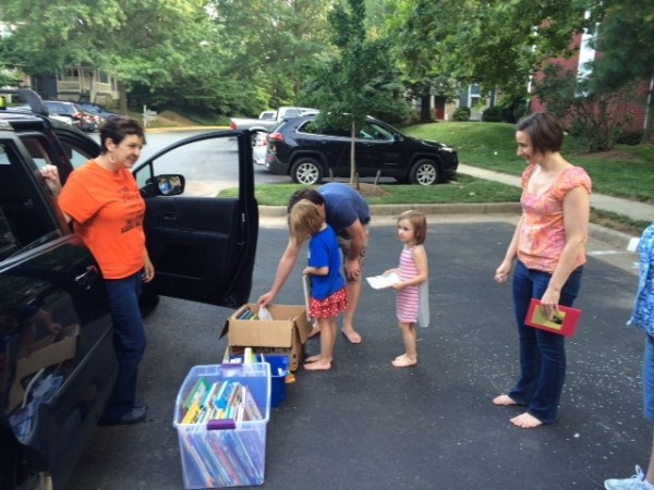 Terraset staffer Deana Dueno (left) bringing summer reading to kids/Credit: Deana Dueno