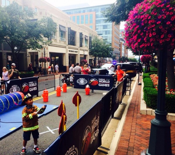 Kids try out fire activities at Fairfax 2015 World Police & Fire Games Sports Extravaganza/Credit: Reston Town Center