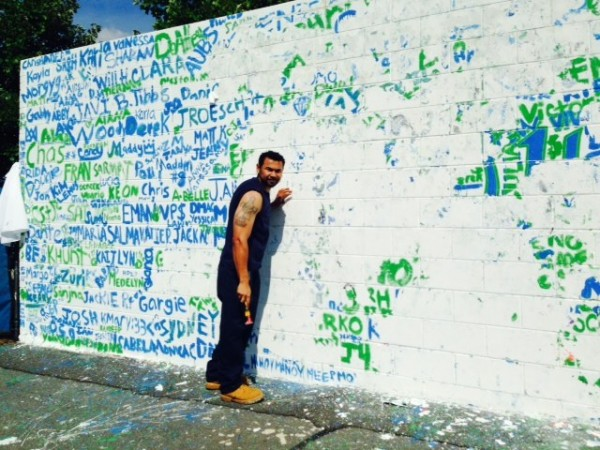 "Workers prep South Lakes High School's ""Senior Wall"" for the Class of 2015"