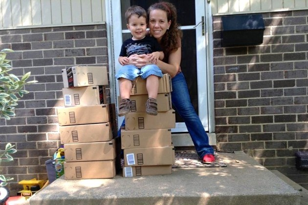 Heather Robertson, with her 2-year-old son, receives stacks of Amazon boxes full of medical supplies daily. (Courtesy of Heather Robertson)