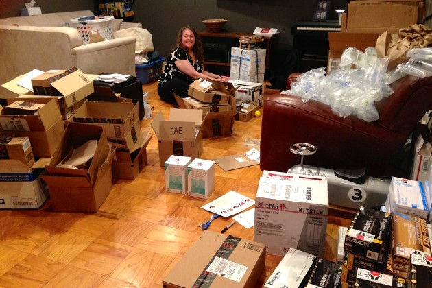Friends sorted through boxes of medical supplies in the Robertsons' home. (Courtesy of Heather Robertson)