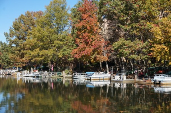 Boats at Lake Thoreau in fall