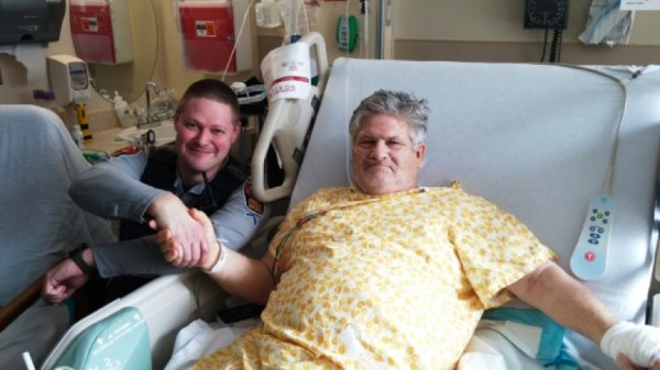 Officer Nathan Keysor (l) visits Jim Cassell in the hospital/Credit: FCPD