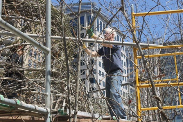 Artist Patrick Dougherty at work at Town Square Park