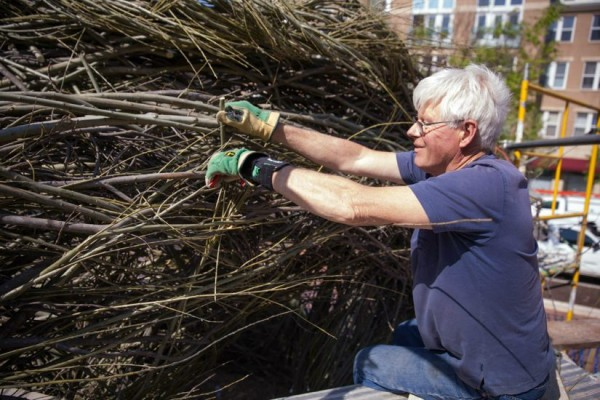 Artist Patrick Dougherty puts finishing touches on sculpture in Reston/Credit: Reston Association