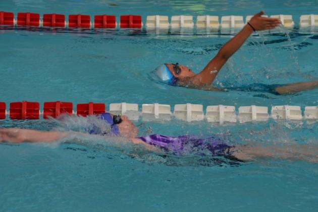 Lake Audubon's Danielle Elliott (bottom) and Newbridge's Clara Sgambati  race in the girls 9-10 50-meter Backstroke/RSTA