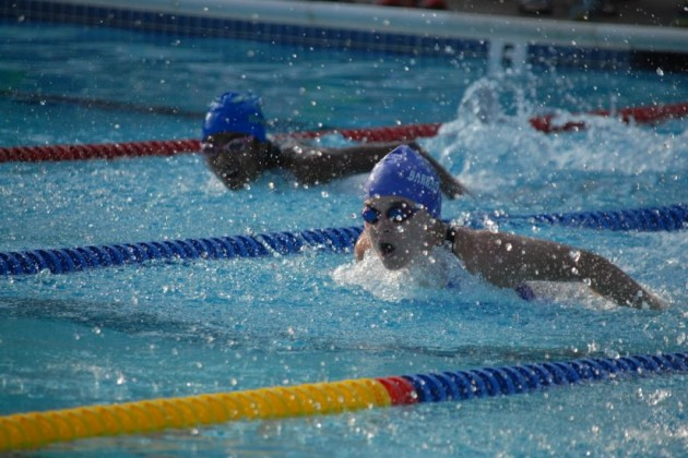 Sydney Cook (Lake Audubon) and Diya Murthy (Autumnwood) compete in the Girls 13-14 50-meter Butterfly/RSTA