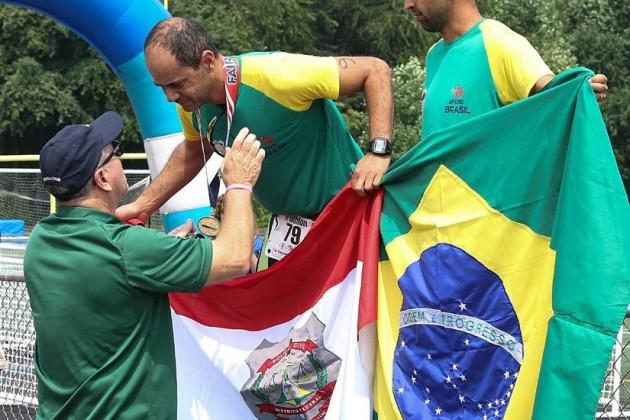 Silva's teammates accept triathlon medal on his behalf/Credit:  WPFG