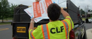 Fairfax County worker removing signs/Credit: Fairfax County
