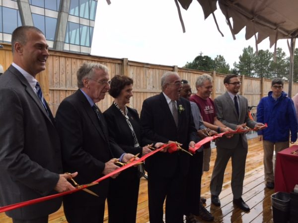 Del. Ken Plum (second from left), Supervisor Chair Sharon Bulova and Rep. Gerry Connolly among VIPS cutting bikeshare ribbon in Reston