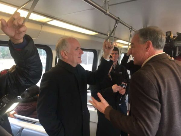 Metro General Manager Paul Wiedefeld and Sen. Tim Kaine (D-Va.) ride the Silver Line (Photo via Twitter/Tim Kaine)