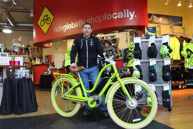 Todd Mader, of The Bike Lane, with an electric bike at his store in Reston Town Center.