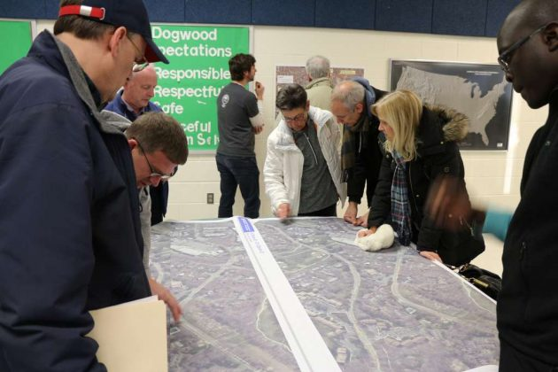 Residents look over maps of proposed street design changes.