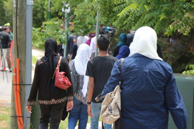 Mourners make their way to the ADAMS Center for a service for Nadra Hassanen.