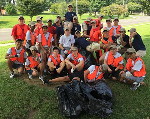 Cadets take a breather after completing a cleanup of Dranesville Road. (FCPS)