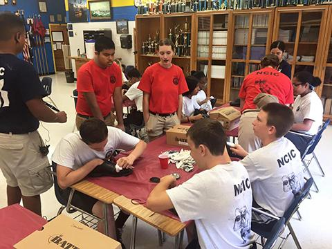 Freshmen in the NJROTC program learned uniform care during summer camp. (FCPS)