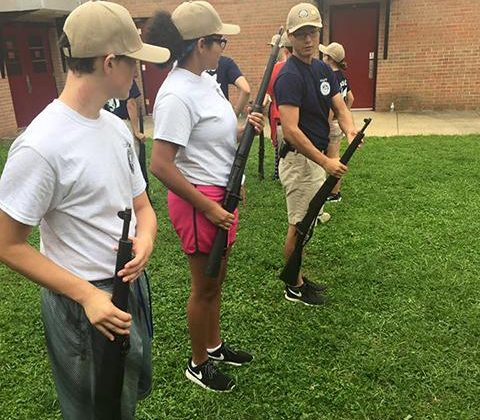 Herndon HS NRJOTC cadets learn the proper way to handle a rifle. (FCPS)