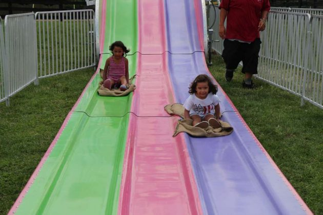 Adriana and Valentina Demony, of Falls Church, ride the giant slide.