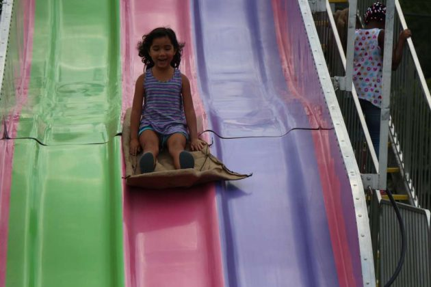 Olivia Demony, of Falls Church, rides the giant slide.