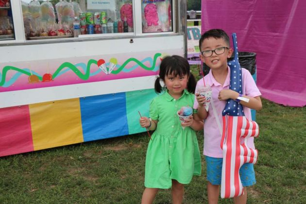 Amber and Andrew Ton, of Burke, enjoy Sno-Cones.