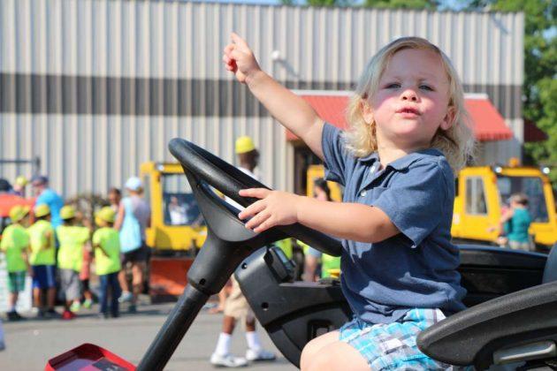 """Alden Wheeler, of Warrenton, enjoys the """"Totally Trucks"""" event."""