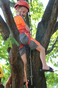 Jack Blanchard, of Herndon, climbs a tree with help from RA staff.