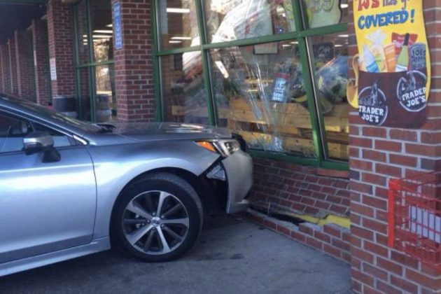 A vehicle crashed into Trader Joe's around 1:30 p.m. today. (Photo via Twitter @stultzat)