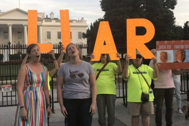Clad in Neon Yellow, Local Group Joins 'Kremlin Annex' Protest for ...