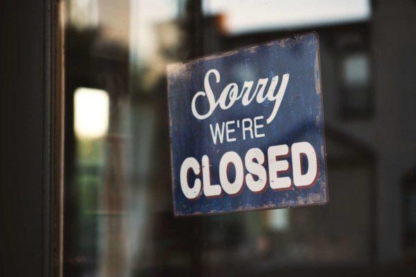 Closed sign (Photo via Tim Mossholder/Unsplash)